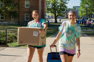 Student moving into residence hall